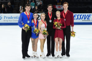 CHICAGO, IL - OCTOBER 22: (L-R) Brandon Frazier and Haven Denney of the United States, Julianne Seguin and Charlie Bilodeau of Canada and Evgenia Tarasova and Vladimir Morozov of Russia pose with their medals on day 2 of the Grand Prix of Skating at the Sears Centre Arena on October 22, 2016 in Chicago, Illinois. (Photo by Stacy Revere - ISU/ISU via Getty Images)